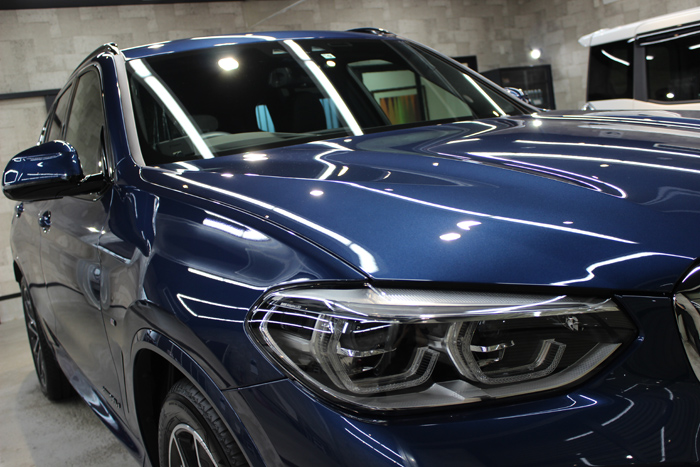 BMW X3 ファイトニックブルー ヘッドライト右